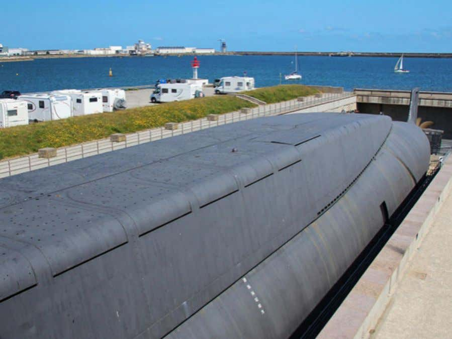 "legendary ""periscope depth."" Hatches The 16 missile hatches, with the lovely Cherbourg harbor in the background."
