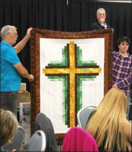 "sponse from the parish has been good,"" added O'Leary. Mason Cockx auctioning off a Cross quilt"