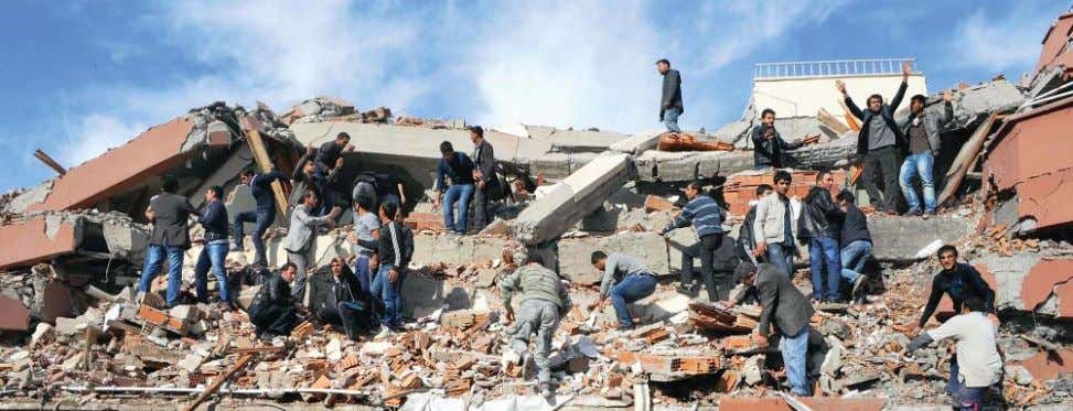 NPP Search and rescue operation at a residential building destroyed by earthquake, Van, Turkey, October 23,