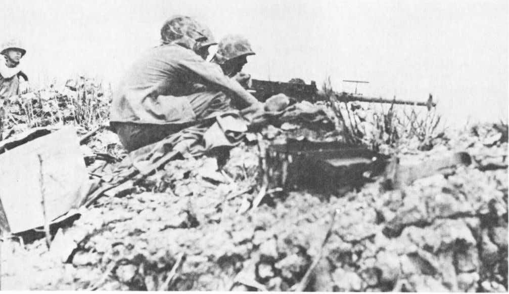 across the relatively flat terrain of southwestern Saipan. A .50 caliber machine gun crew fires at