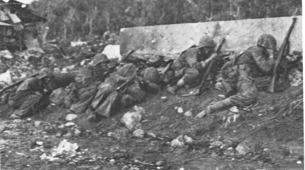 the senior officers in the 8th Marines. (USMC Photo #86530) Marines on Saipan crouch low as