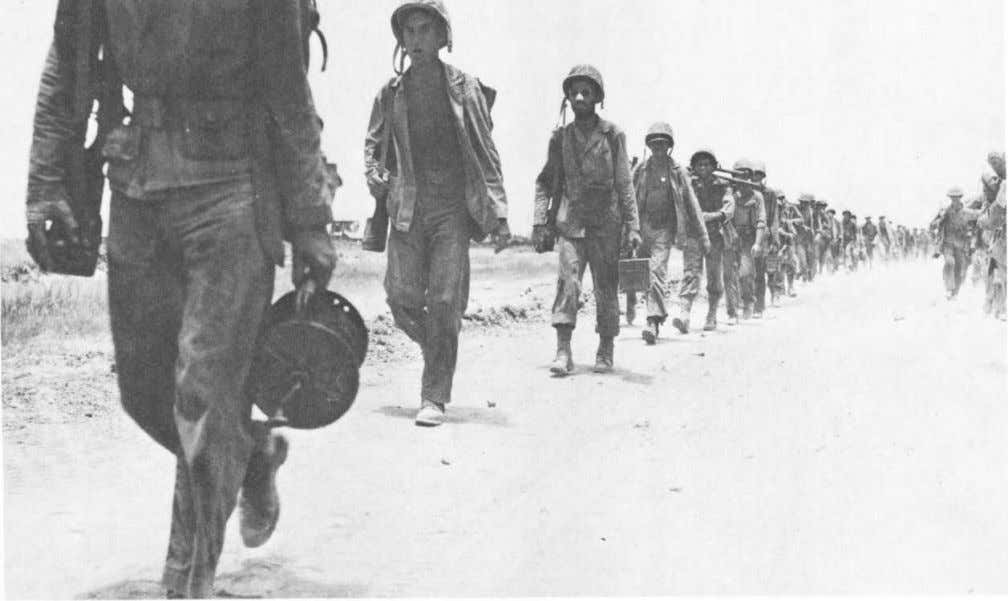 here during the Okinawa campaign. (USMC Photo #12688) Men of the 8th Marines march across Naha
