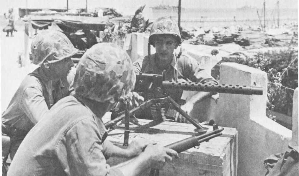 Marines from the 1st Battalion, 8th Marines with a .30 caliber air cooled machine gun