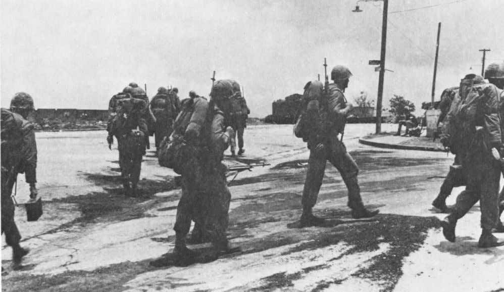 The 1st Battalion, 8th Marines moves up on 9 May 1965 to relieve the 3d