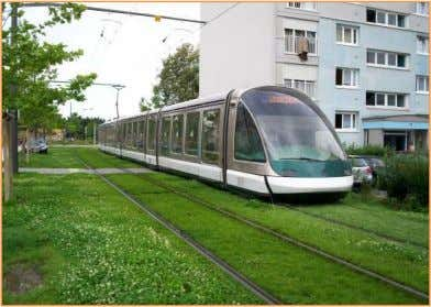 in the street. Stations: Figure 4 the grooved rail. Figure 5 a grassed track in Europe.