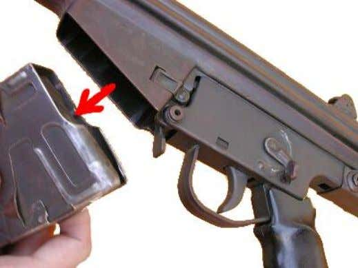 CETME for dummies - Field Stripping Then, we'll remove the magazine pulling it downwards. The next