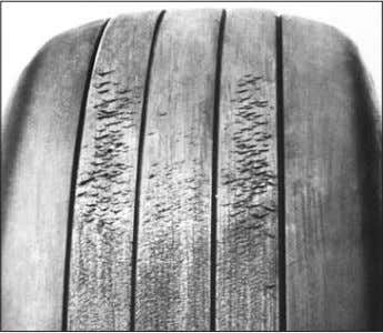 for continued service. See picture of a typical example of chevron cutting in the tread photo