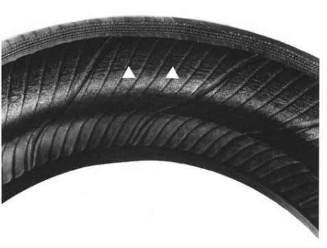 surface rubber. Tire is to be scrapped. CASING CONDITIONS Inner Tire Breakdown Deterioration (distorted/wrinkled