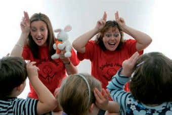 Suzanne and Tracy do the RABBIT sign as they sing 'I dig my garden' Singing