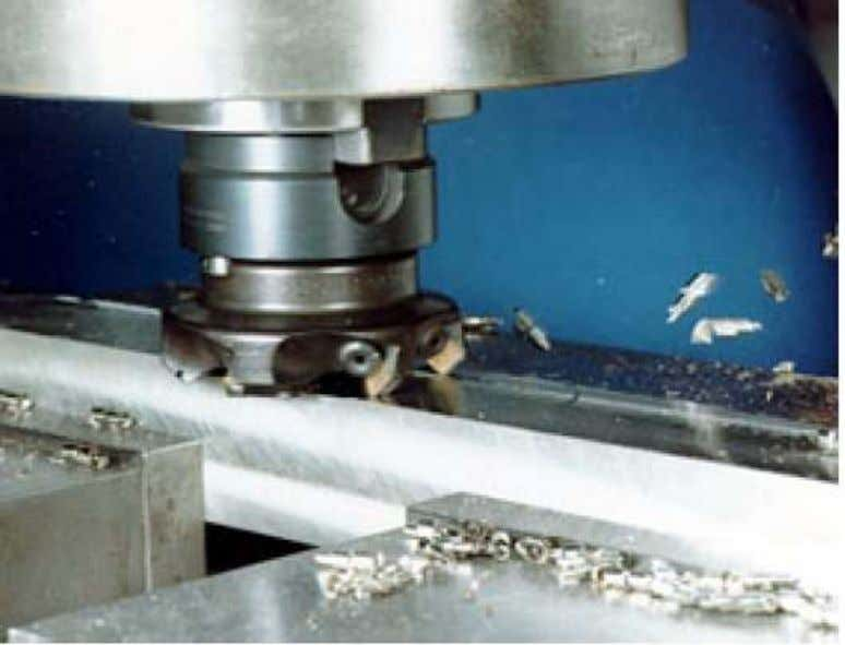 operation. The face-milling cutter machines the entire surface. The cutter diameter is greater than the workpart