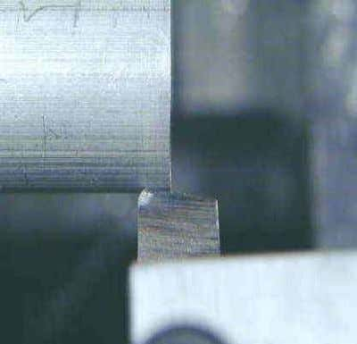 to reduce the diameter of the workpiece, usually to a specified dimension, and to produce a