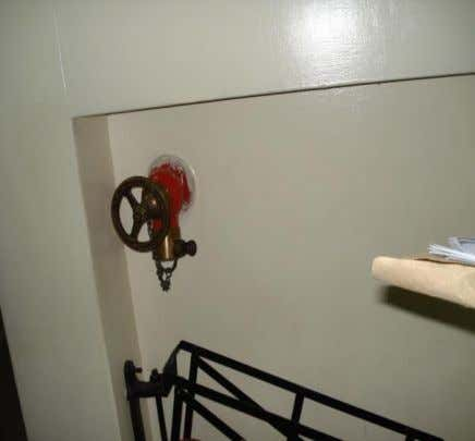 Photograph 3: Missing Firefighting Hosereel Equipment at Jogoo House A Attributed to Vandalism. Photograph 4: Missing