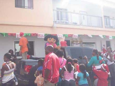 Santa gathering at ARC Agency. Dora the Explorer was favorite. Santa had presents for all the