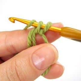 is tightly closed. 3. Yarn over and draw through the loop. 6. Draw up a loop.