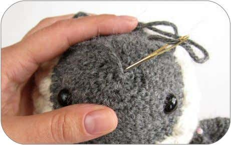 Draw the yarn through. Pick up all the remaining stitches. 4. Insert the needle into the