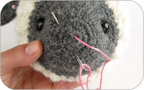 a bit. d ) Embroider the nose. Draw each stitch quite tight. 1. Insert the needle