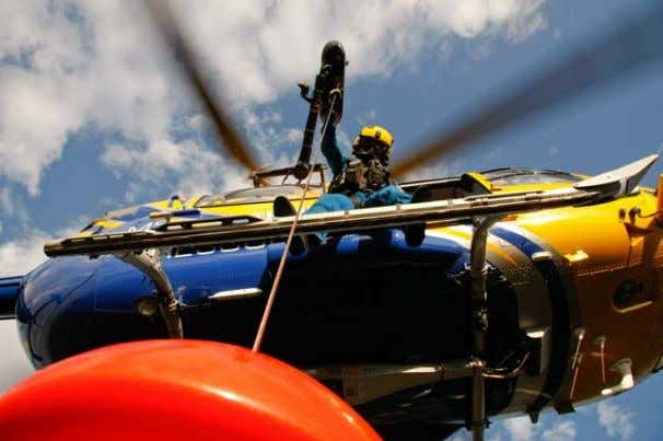 fill the aircraft cabin with subjects during a rescue. 3 4 Figure 21- Hoist operator with