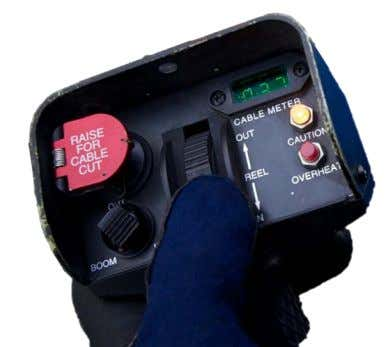 "when touching something that conducts electricity"". 4 3 Figure 26- Cable cutter control. Red guarded switch"