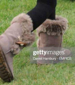 with fleece. The outer surface is lined with sheep hide. Boots made from sheep fleece and