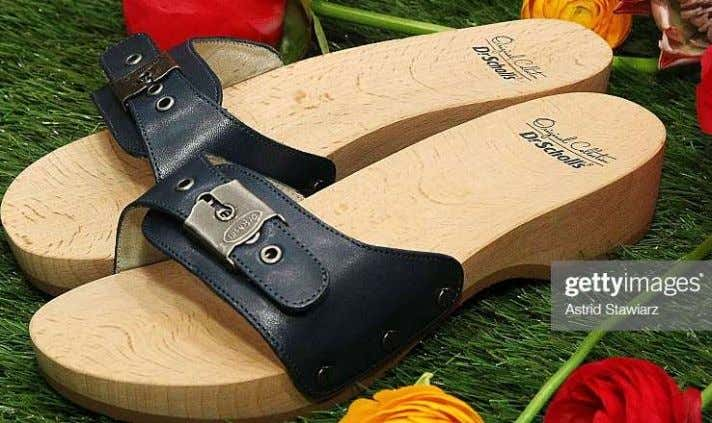 wooden sole may promote sound posture for certain persons. The open top design of Dr. Scholl's