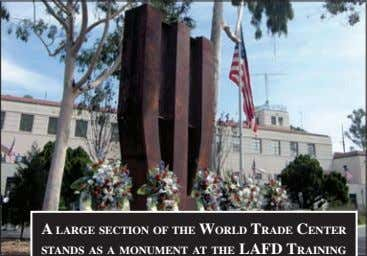 a large seCtioN of the world trade CeNter staNds as a MoNuMeNt at the lafd