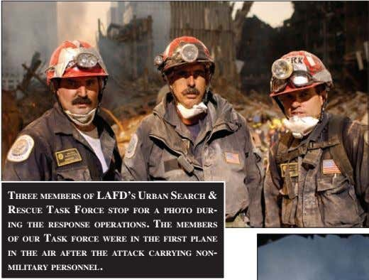 three MeMbers of lafd's urbaN searCh & resCue task forCe stop for a photo dur-