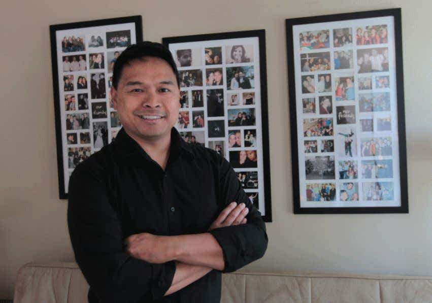 Glen Bacarro, framed by photos of friends and family in his Windsor home, is a
