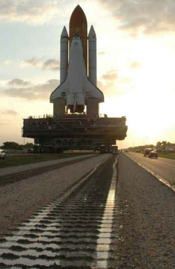updates on the NASA mission, visit http://www.nasa.gov . THE SPACE Shuttle Atlantis slowly moves along the