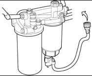 housing, then tighten the primary fuel filter 1/2-3/4 turn. 11. Connect the electrical connector for the