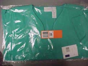 Placement of UPC stickers of flat pack garments should be center front of polybag.