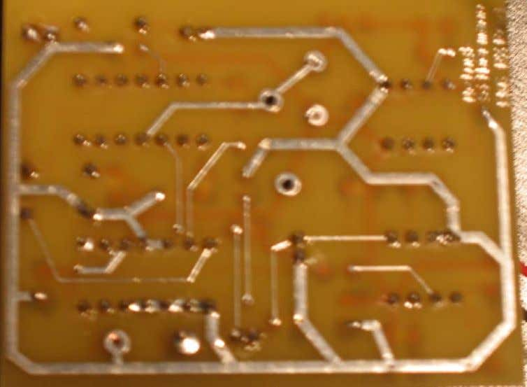 "Figure 40: Underside of final receiver PCB (1.9"" x 2.5"") Figure 41: Radio and receiver"