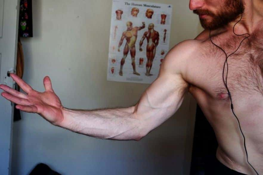 2. Now try to flex your bicep as hard as possible while making a fist