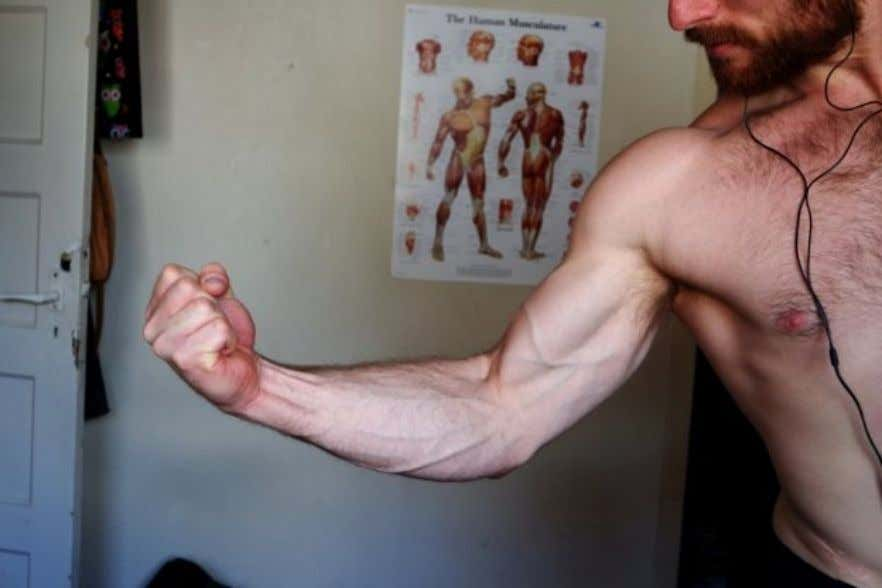2. Now try to flex your bicep as hard as possible while making a fist and