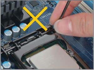 the front end of the load plate is under the shoulder screw. NOTE: Hold the CPU