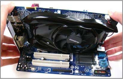 Installing and Removing a PCI Express Graphics Card: • Installing a Graphics Card: Gently push down