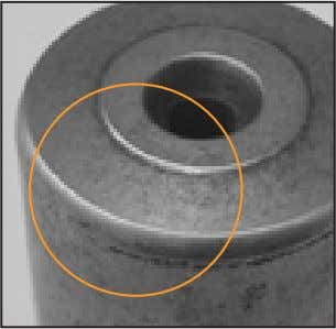 caused abrasive wear on this tapered roller bearing. Fig. 2. The roller end wear on this