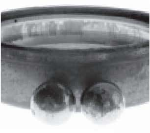 damage is shown on this ball bearing inner ring and cage. Fig. 16. This ball bearing