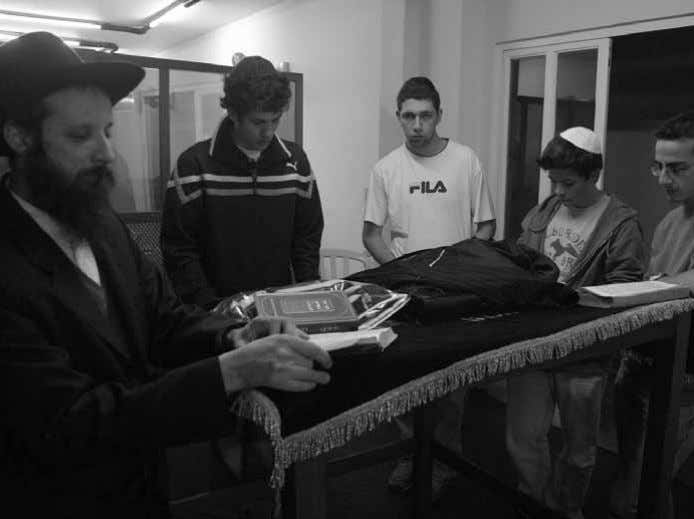 street, administered by the shliach, R' Shimon Brand. With youngsters in the Chabad House On Erev