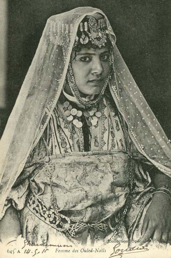 25 Figure 27: Femme des Ouled-Nail, Morocco, with flor al henna pattern on woman's arm, 1900