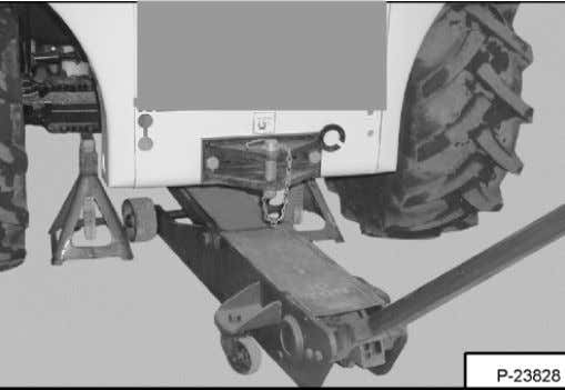 the Telehandler and install jackstands [Figure 10-10-1] . Put the floor jack under the center of