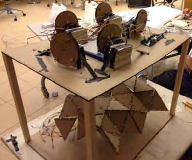 oped a scaled model of their roof structure. The students used simple laser-cut triangular MDF connected
