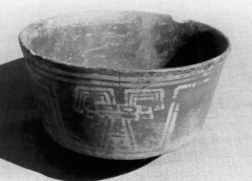 Joan M. Gero Early Intermediate period white-on-red straight-sided bowl; fragments of such bowls were recovered in