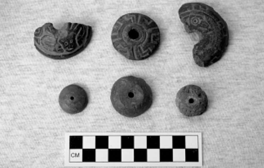 Asking about Aztec Gender Fig. 4 Ceramic spindle whorls from Huexotla, Basin of Mexico: large spindle