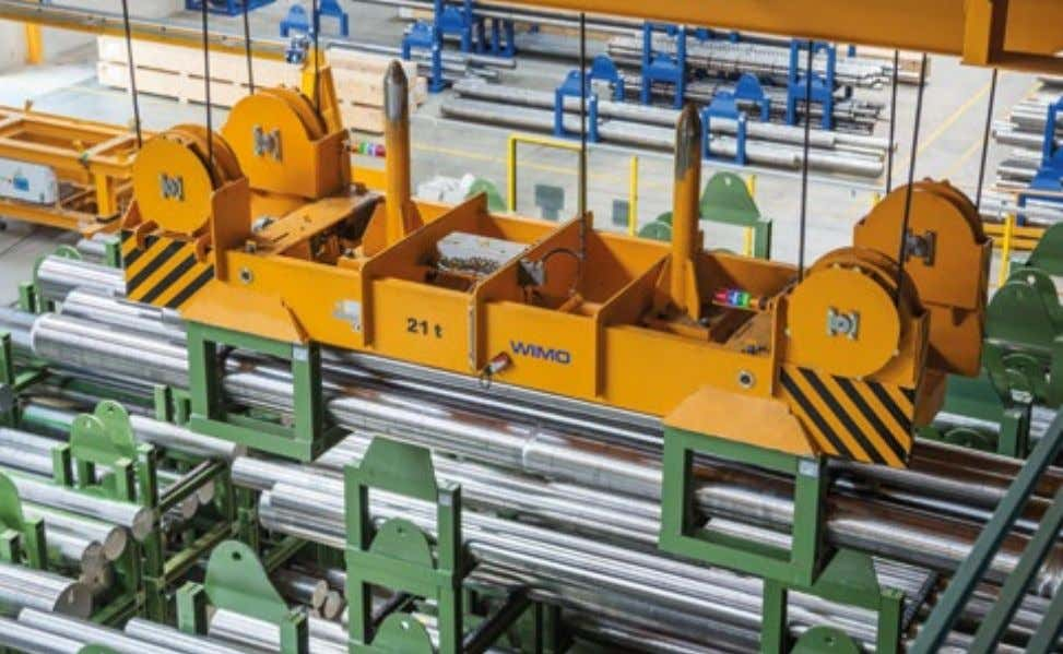 Einlagern von Rundstählen Motor-driven stacking cradle spreader for the automatic transport and storing of steel rods