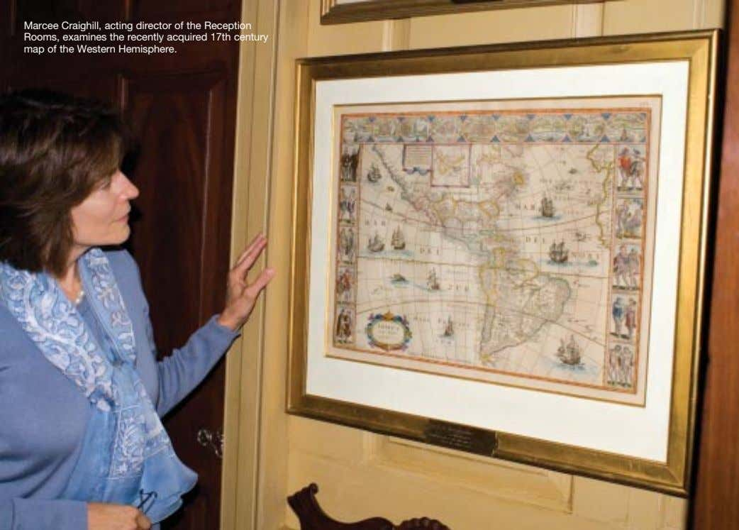 Marcee Craighill, acting director of the Reception Rooms, examines the recently acquired 17th century map