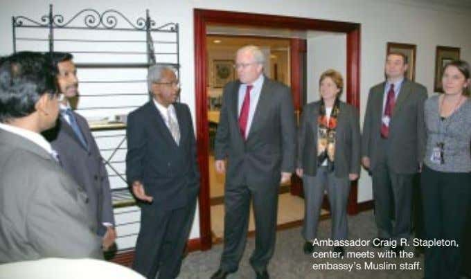 Ambassador Craig R. Stapleton, center, meets with the embassy's Muslim staff.