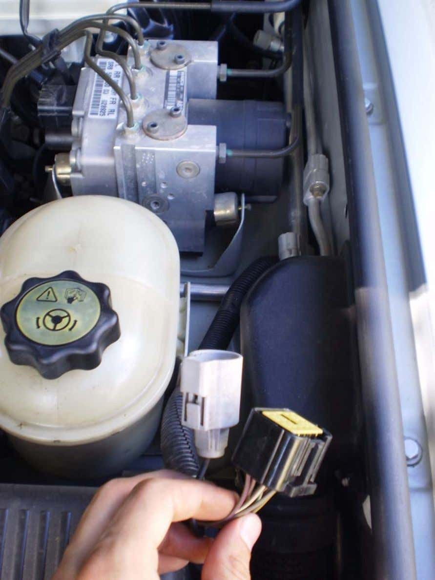 ABS Mod - LAND ROVER CLUB V.I. Place harness between intake and steering fluid reservoir 4.