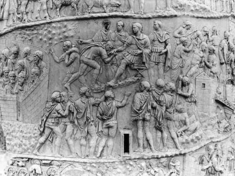 FIGURE 15 Rome, Column of Trajan, XLII–XLV. Dona militaria. style walled city with beautifully rendered
