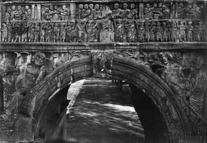 FIGURE 34 Rome, Arch of Constantine. Liberalitas. the people of Rome with money, but here