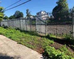 pleasing fence and sidewalk along this stretch of 85th Street. This would essentially mean replacing the